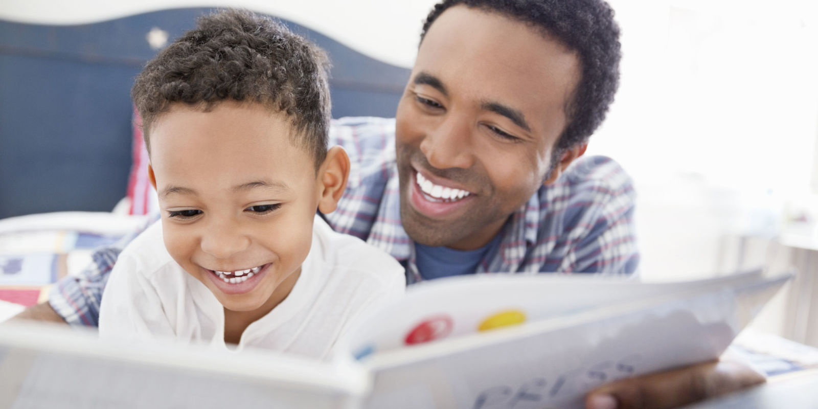 father-reading-to-son-lead