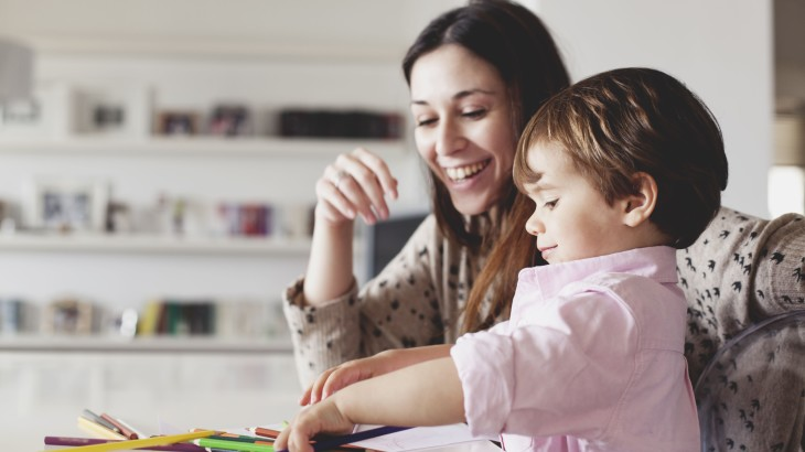 young-mother-help-her-son-with-drawing